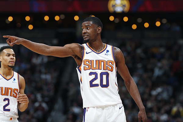 Phoenix Suns forward Josh Jackson (20) in the first half of an NBA basketball game Friday, Jan. 25, 2019, in Denver. (AP Photo/David Zalubowski)
