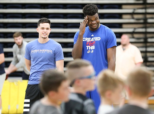 Kansas center Udoka Azubuike and Elijah Elliott have a laugh as they watch over the campers during a Washburn University basketball camp on Tuesday, June 4, 2019 at Lee Arena in Topeka.
