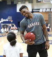Kansas forward Silvio De Sousa (22) jokes with a camper during a Washburn University basketball camp on Tuesday, June 4, 2019 at Lee Arena in Topeka.