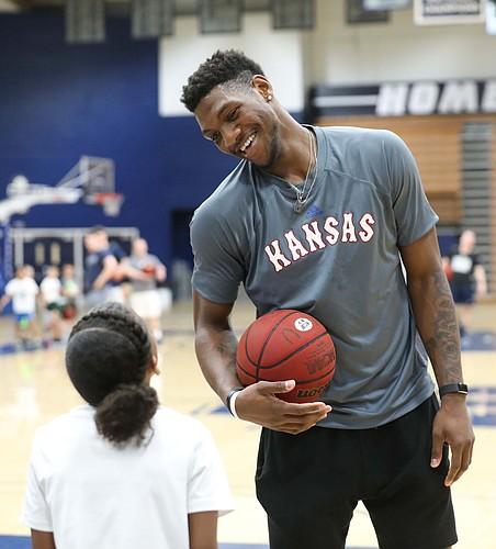 Kansas forward Silvio De Sousa (22) jokes with a camper during a Washburn University basketball camp on Tuesday, June 4, 2019 at Lee Arena in Topeka.