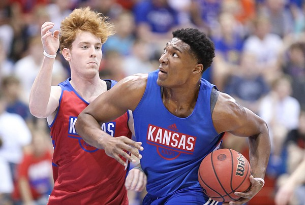 Kansas forward David McCormack drives to the bucket against Kansas guard Chris Teahan during a scrimmage on Tuesday, June 11, 2019 at Allen Fieldhouse.