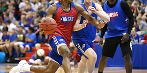 Kansas guard Ochai Agbaji (30) goes hard to the bucket against KU walk-on Michael Jankovic during a scrimmage on Tuesday, June 11, 2019 at Allen Fieldhouse.
