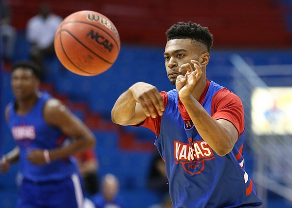 Kansas newcomer Isaac McBride throws a pass during a scrimmage on Tuesday, June 11, 2019 at Allen Fieldhouse.