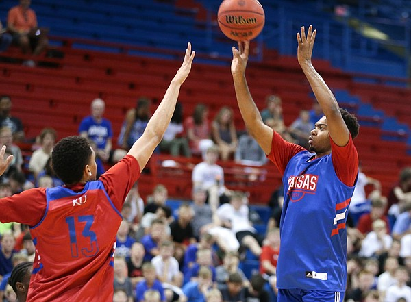 Kansas freshman Isaac McBride puts up a 3 over fellow freshman Tristan Enaruna during a scrimmage on Tuesday, June 11, 2019 at Allen Fieldhouse.
