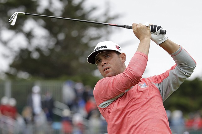 Gary Woodland watches his tee shot on the fourth hole during the final round of the U.S. Open Championship golf tournament Sunday, June 16, 2019, in Pebble Beach, Calif. (AP Photo/Marcio Jose Sanchez)