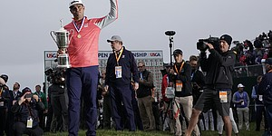 Gary Woodland poses with the trophy after winning the U.S. Open Championship golf tournament Sunday, June 16, 2019, in Pebble Beach, Calif. (AP Photo/David J. Phillip)