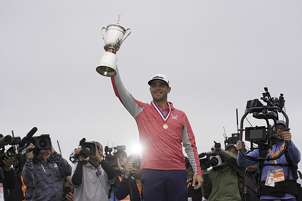 Gary Woodland poses with the trophy after winning the U.S. Open Championship golf tournament Sunday, June 16, 2019, in Pebble Beach, Calif. (AP Photo/Carolyn Kaster)
