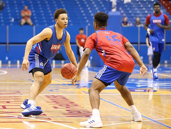 Kansas guard Devon Dotson looks to make a move against Kansas guard Isaac McBride during a scrimmage on Tuesday, June 18, 2019 at Allen Fieldhouse.