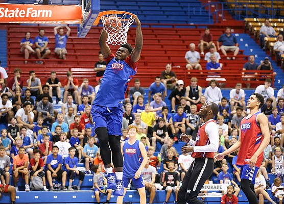 Kansas center Udoka Azubuike comes in for a dunk past former Kansas guard Tyshawn Taylor and current forward Tristan Enaruna during a scrimmage on Tuesday, June 18, 2019 at Allen Fieldhouse.