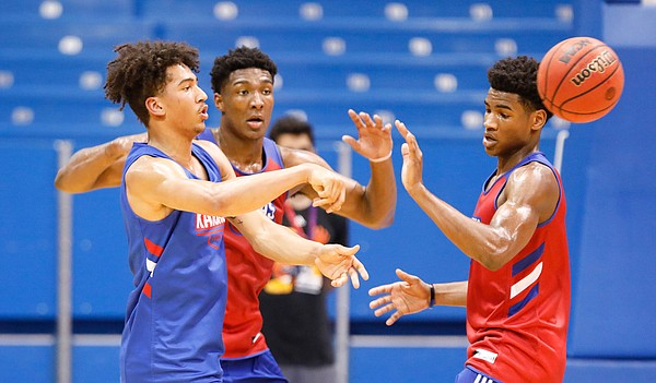 Kansas forward Jalen Wilson throws a pass beyond Kansas forward David McCormack and Kansas guard Ochai Agbaji during a scrimmage on Tuesday, June 18, 2019 at Allen Fieldhouse.