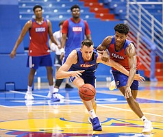 Kansas forward Mitch Lightfoot and Kansas guard Ochai Agbaji compete for a ball during a scrimmage on Tuesday, June 18, 2019 at Allen Fieldhouse.