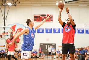 Red Team guard Frank Mason III puts up a three over Blue Team guard Clay Young during the Rock Chalk Roundball Classic on Thursday, June 20, 2019 at Eudora High School.