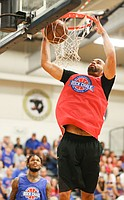 Red Team forward Perry Ellis puts down a dunk before Blue Team guard Ben McLemore during the Rock Chalk Roundball Classic on Thursday, June 20, 2019 at Eudora High School.
