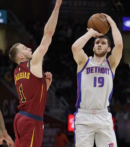 Detroit Pistons' Sviatoslav Mykhailiuk (19), from Ukraine, shoots against Cleveland Cavaliers' Nik Stauskas (1) in the first half of an NBA basketball game, Saturday, March 2, 2019, in Cleveland. (AP Photo/Tony Dejak)