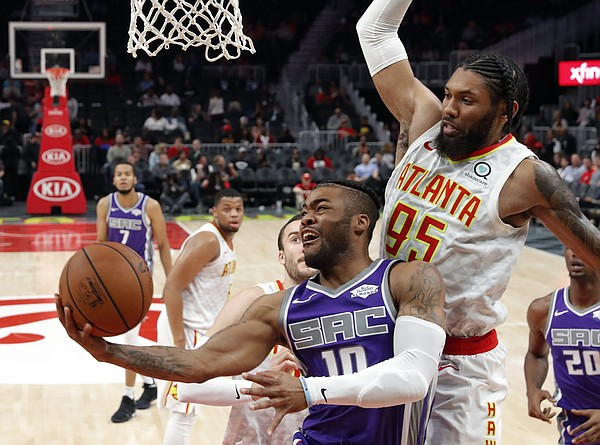 FILE — Sacramento Kings guard Frank Mason III (10) goes in for a basket as Atlanta Hawks forward DeAndre' Bembry (95) defends during the second half of an NBA basketball game Thursday, Nov. 1, 2018, in Atlanta. The Kings waived Mason on July 4, 2019, making him a free agent. (AP Photo/John Bazemore)
