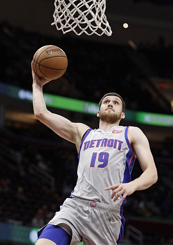 Detroit Pistons' Sviatoslav Mykhailiuk (19), from Ukraine, dunks the ball against the Cleveland Cavaliers in the first half of an NBA basketball game, Saturday, March 2, 2019, in Cleveland. (AP Photo/Tony Dejak)