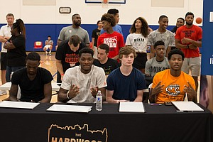 Juniors Marcus Garrett and Silvio De Sousa, along with freshman Christian Braun and sophomore Ochai Agbaji judged the slam dunk contest at the Hardwood Classic AAU event in Lawrence on Friday night.