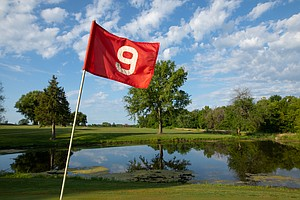 The number 9 hole at Hidden Springs Golf Course in Overbrook, Kan. The green on the ninth hole sits just beyond a pond off to the right of the fairway.