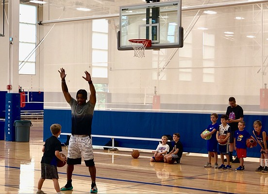 Former KU point guard Frank Mason III walls up on a young camper during the third annual Frank Mason Basketball Camp on Friday, Aug. 2, 2019, at Sports Pavilion Lawrence.