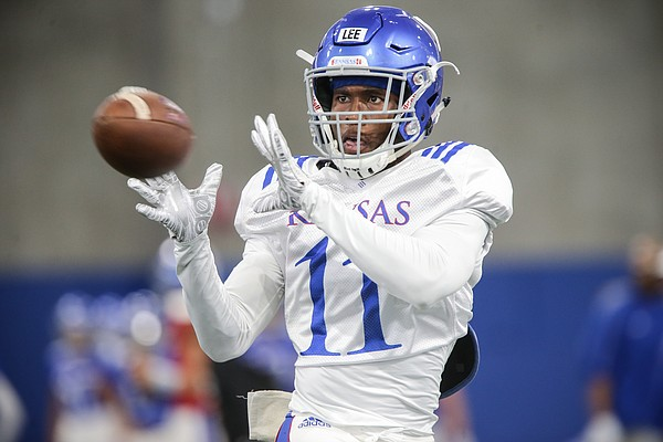 Kansas safety Mike Lee eyes a pass during practice on Thursday, Aug. 8, 2019.