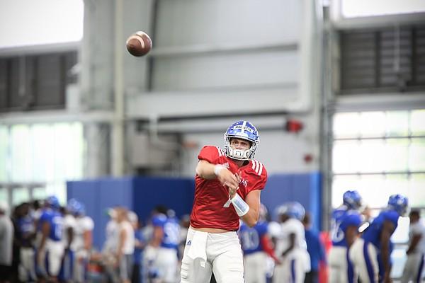 Kansas quarterback Thomas MacVittie throws during practice on Thursday, Aug. 8, 2019.