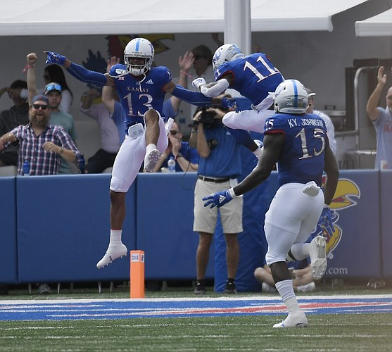 Kansas corner back Hasan Defense celebrated with safety Mike Lee after intercepting and scoring a touchdown Saturday afternoon at David Booth Kansas Memorial Stadium on Aug. 31, 2019.