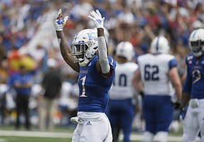 Kansas safety Mike Lee throws up his arms after making a stop on third down Saturday afternoon at David Booth Kansas Memorial Stadium on Aug. 31, 2019.
