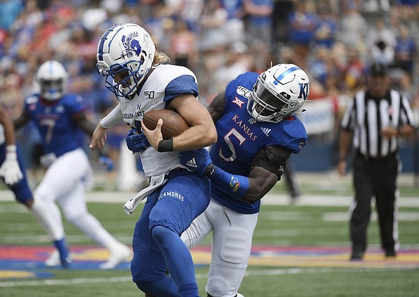 Kansas linebacker Azur Kamara takes down Indiana State's quarterback Ryan Boyle Saturday afternoon at David Booth Kansas Memorial Stadium on Aug. 31, 2019.