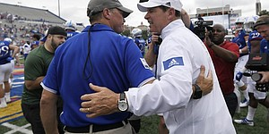 Kansas head coach Les Miles met with Indiana State head coach Curt Mallory after the game Saturday afternoon at David Booth Kansas Memorial Stadium on Aug. 31, 2019.