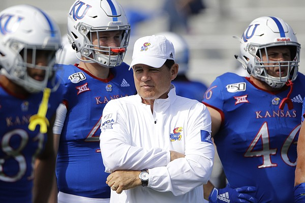 Kansas head coach Les Miles watches practice before an NCAA college football game against Indiana State Saturday, Aug. 31, 2019, in Lawrence, Kan. (AP Photo/Charlie Riedel)