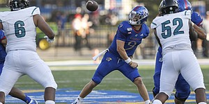 Kansas quarterback Carter Stanley fumbles the ball as he tries to make a pass against Coastal Carolina Saturday night at David Booth Kansas Memorial Stadium on Sept. 7, 2019.
