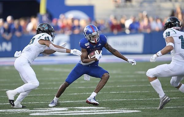 Kansas running back Pooka Williams Jr. tries to find an opening against Coastal Carolina Saturday night at David Booth Kansas Memorial Stadium on Sept. 7, 2019.