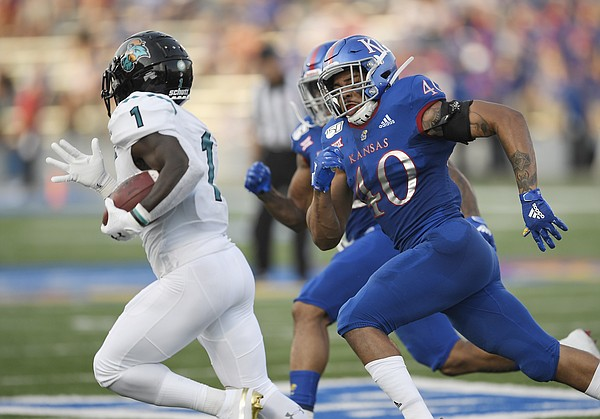Kansas linebackern Dru Prox chases down Coastal Carolina's CJ Marable Saturday night at David Booth Kansas Memorial Stadium on Sept. 7, 2019.