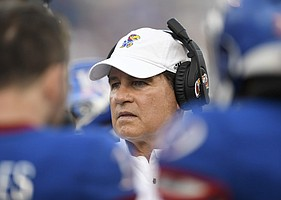 Kansas head coach Les Miles talks to his team during a timeout against Coastal Carolina Saturday night at David Booth Kansas Memorial Stadium on Sept. 7, 2019.