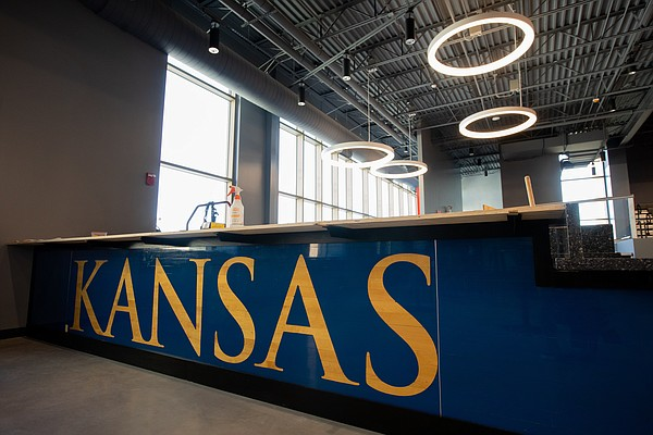 The border of a bar that is still under construction at Horejsi Family Volleyball Arena features sections of the old court from the University of Kansas volleyball team's previous facility, Wednesday, Sept. 11, 2019.