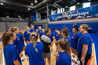 Kansas volleyball head coach Ray Bechard talks with his team before practice at the new Horejsi Family Volleyball Arena on Wednesday, Sept. 11, 2019.