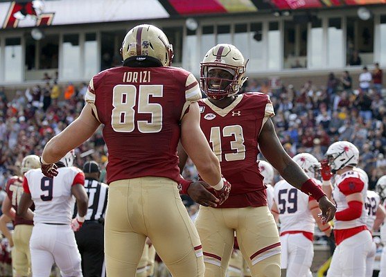 Boston College quarterback Anthony Brown (13) celebrates with tight end Korab Idrizi (85) after connecting for a touchdown during the first half of an NCAA college football game against Richmond, Saturday, Sept. 7, 2019, in Boston. (AP Photo/Mary Schwalm)
