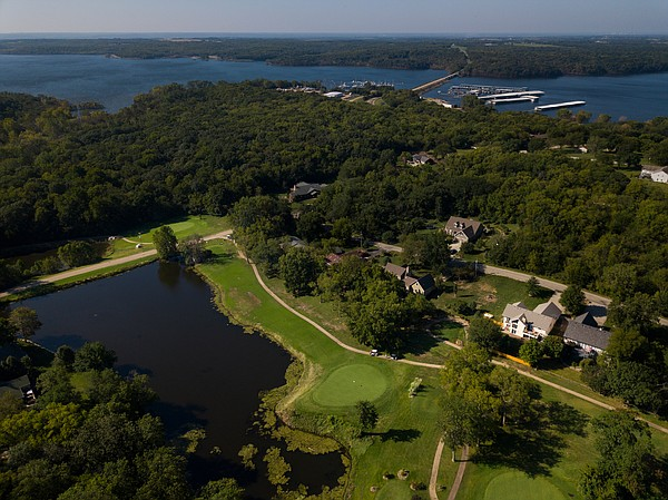 Just on the other side of Lake Perry and nestled between two rows of country homes and a sizable pond protecting the peninsula green, the 14th hole at Lake Perry Country Club is the signature hole at the quaint country course.