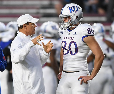 (Boston, MA, 09/13/19) Kansas Jayhawks head coach Les Miles, left, talks with punter Kyle Thompson (80) prior to the start of an NCAA football game at Boston College in Boston, Mass., on Friday, September 13, 2019.