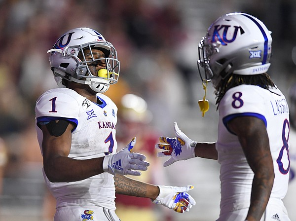 (Boston, MA, 09/13/19) Kansas Jayhawks running back Pooka Williams Jr. (1) is congratulated by teammate Kwamie Lassiter II (8) after Williams scored a touchdown against the Boston College Eagles during the third quarter of an NCAA football game at Boston College in Boston, Mass., on Friday, September 13, 2019.