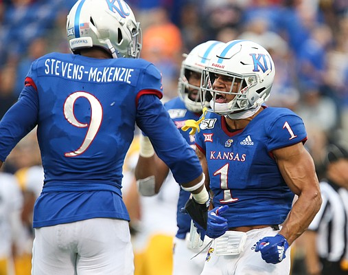 Kansas safety Bryce Torneden (1) celebrates with Kansas linebacker Najee Stevens-McKenzie (9) after a defensive stop during the fourth quarter on Saturday, Sept. 21, 2019 at David Booth Kansas Memorial Stadium.
