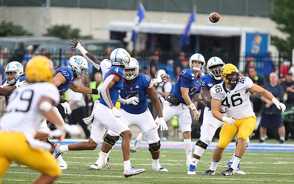 Kansas quarterback Carter Stanley (9) throws to Kansas wide receiver Andrew Parchment (4) late in the fourth quarter on Saturday, Sept. 21, 2019 at David Booth Kansas Memorial Stadium.
