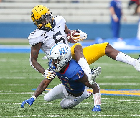 Kansas safety Mike Lee (11) takes out West Virginia running back Kennedy McKoy (6) after a catch during the first quarter on Saturday, Sept. 21, 2019 at David Booth Kansas Memorial Stadium.