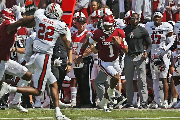 Oklahoma quarterback Jalen Hurts (1) carries in the second quarter of an NCAA college football game against Texas Tech in Norman, Okla., Saturday, Sept. 28, 2019. (AP Photo/Sue Ogrocki)