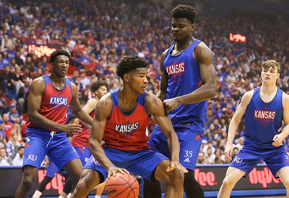 Kansas guard Ochai Agbaji (30) looks to drive around Kansas center Udoka Azubuike (35) during Late Night in the Phog on Friday, Oct. 4, 2019 at Allen Fieldhouse.