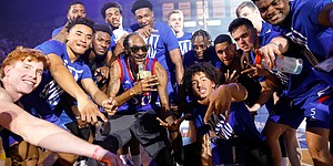 Rapper Snoop Dogg gets in for a photo with The Jayhawks as he performs for the Allen Fieldhouse crowd during Late Night in the Phog on Friday, Oct. 4, 2019 at Allen Fieldhouse.