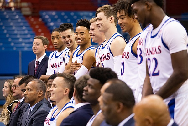 Members of the Kansas men's basketball team laugh as they prepare for the official team portrait during Media Day on Wednesday, Oct. 9, 2019 at Allen Fieldhouse.