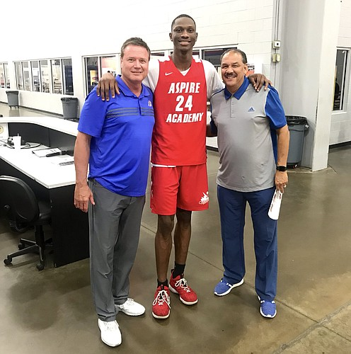 Gethro Muscadin during a recent visit with KU coaches Bill Self and Kurtis Townsend. Photo courtesy @aspireacademyky