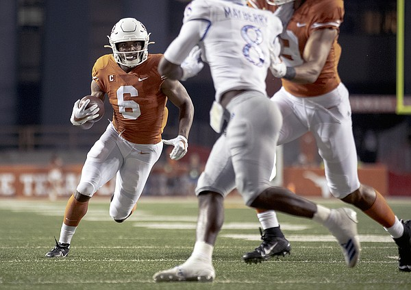 Texas wide receiver Devin Duvernay (6) runs for a touchdown against Kansas during an NCAA college football game Saturday, Oct. 19, 2019, in Austin, Texas. (Nick Wagner/Austin American-Statesman via AP)