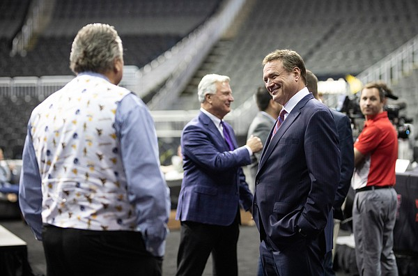 Kansas head coach Bill Self jokes with West Virginia head coach Bob Huggins during Big 12 Media Day on Wednesday, Oct. 23, 2019 at Sprint Center in Kansas City.